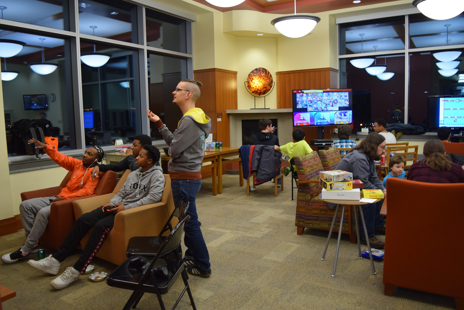 Librarian Zorian Sasyk, standing, with video gamers at Game Night on Feb. 19, 2019. (Margot M. Barry / The Metropolitan)