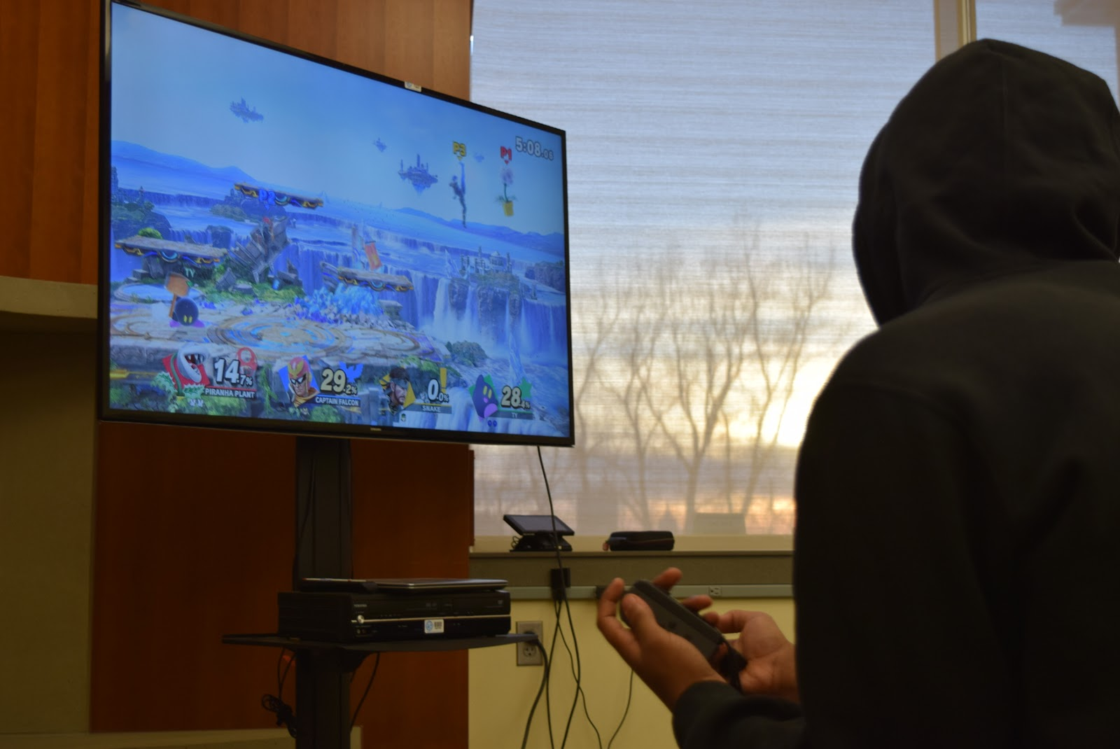 "Nintendo gamers play ""Super Smash Bros."" (Margot M. Barry / The Metropolitan)"