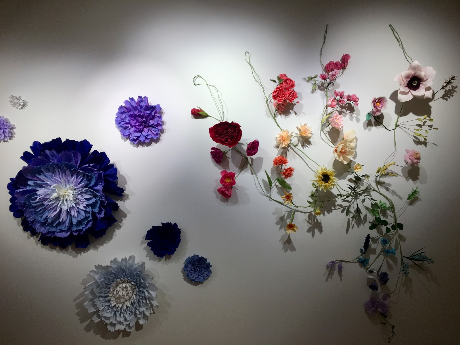 "Dawn Cramer's paper flowers in the 2019 Student Salon in the Gordon Parks Gallery, Metropolitan State University Library and Learning Center, 645 E. Seventh St., St. Paul. Her work is also on view in ""Botanicals"" through March 30 at the St. Croix Galleries of ArtReach St. Croix, 224 N. Fourth St., Stillwater.  (Photo by Kathryn Ganfield / The Metropolitan)"