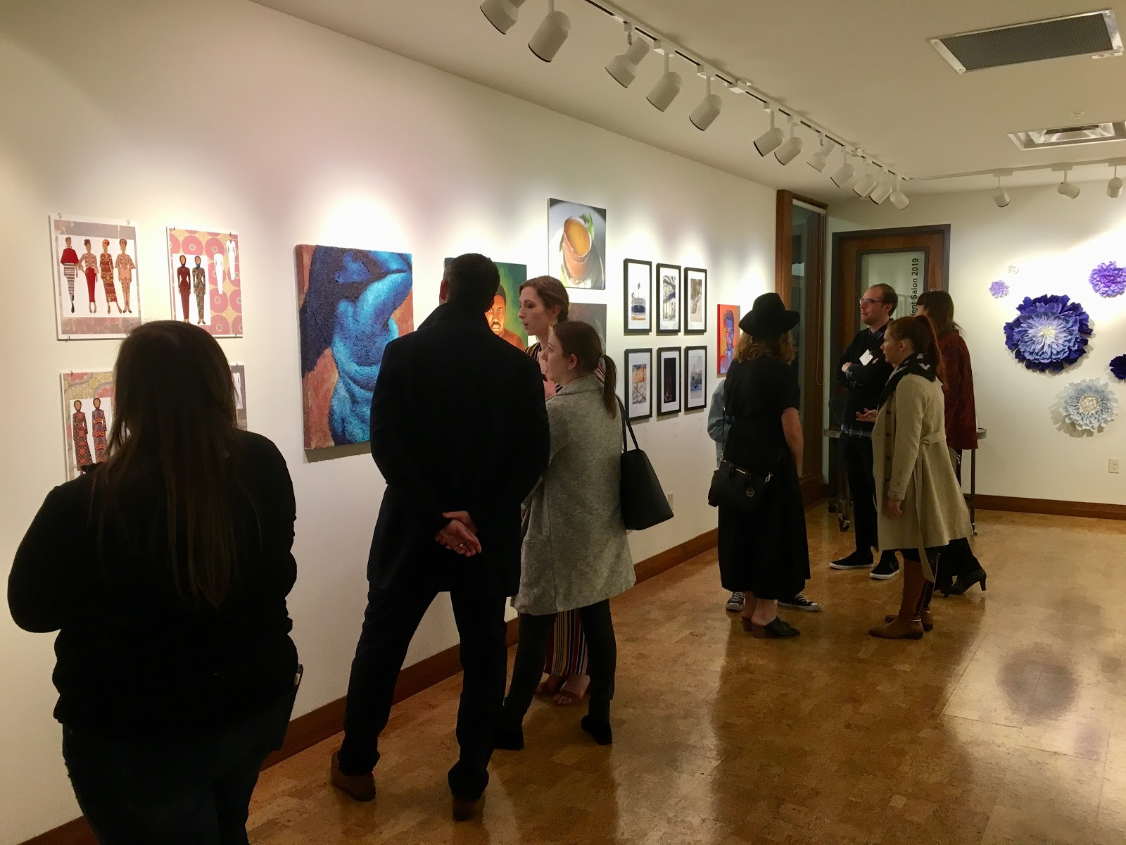 More than 100 people attended the opening night reception of the 2019 Student Salon in the Gordon Parks Gallery on March 21. The show features the work of seven studio arts majors and two individualized studies majors. (Photo by Kathryn Ganfield / The Metropolitan)