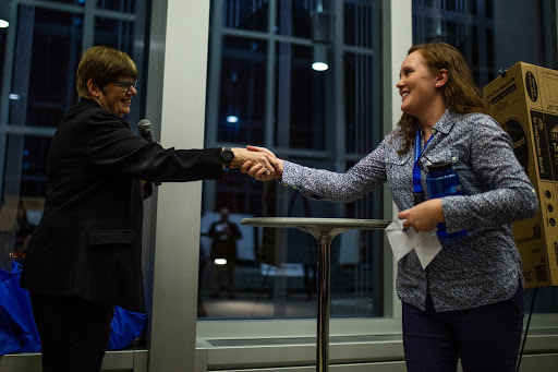 President Ginny Arthur, left, congratulates an award-winning student researcher at the Student Poster Conference in New Main Great Hall on Wednesday, Nov. 28, 2018. Photo by Eli Bartz