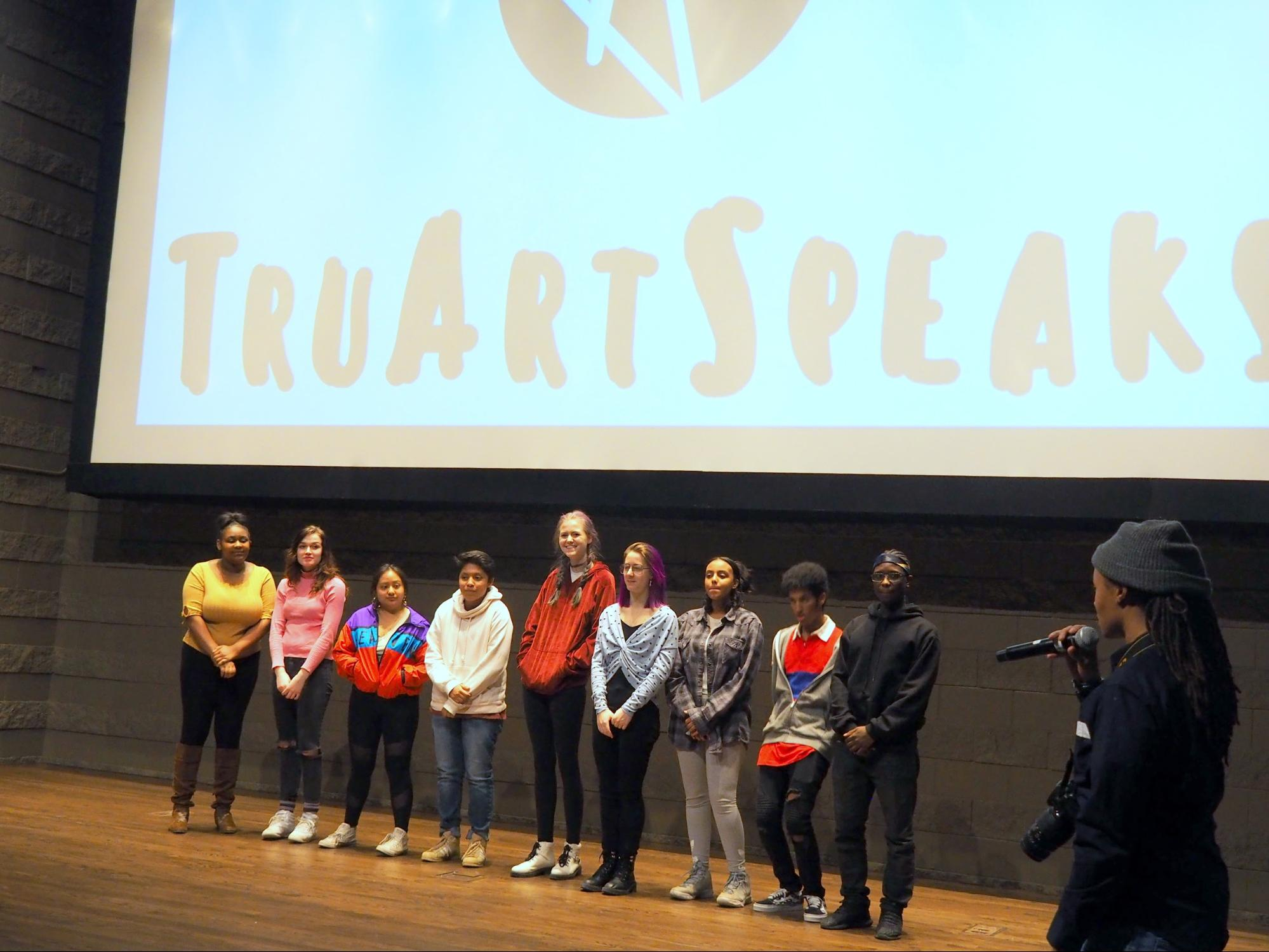 Tish Jones, right, addresses the semifinalists of the BeHeard Youth Poetry Slam competition on March 8 at Metropolitan State University. Jones is executive director of TruArtSpeaks, an organization dedicated to empowering youth voices through hip-hop culture, education, literacy and outreach. The nonprofit organizes the annual competition for high school students from around the Twin Cities region. Students performed original poems and were assessed by a panel of judges. The poets who advanced at this stage went on to compete in the finals on March 30 at Steppingstone Theatre in St. Paul. (April Carlson / The Metropolitan)