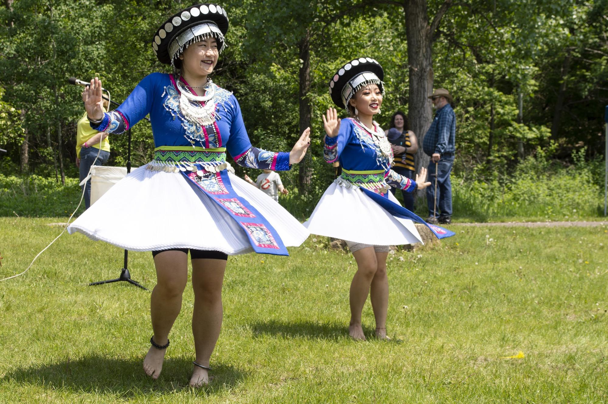 You Lee, left, and Nkauj Sheng dance in traditional Hmong style. They are co-founders of St. Paul's YeS Dance Academy. (Mandy Hathaway / The Metropolitan)