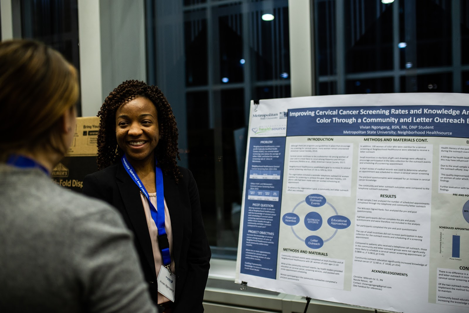 Doctoral nursing student Vivian Ngongang answers questions about her investigation into improving cervical cancer screening rates among women of color. Photo by Eli Bartz