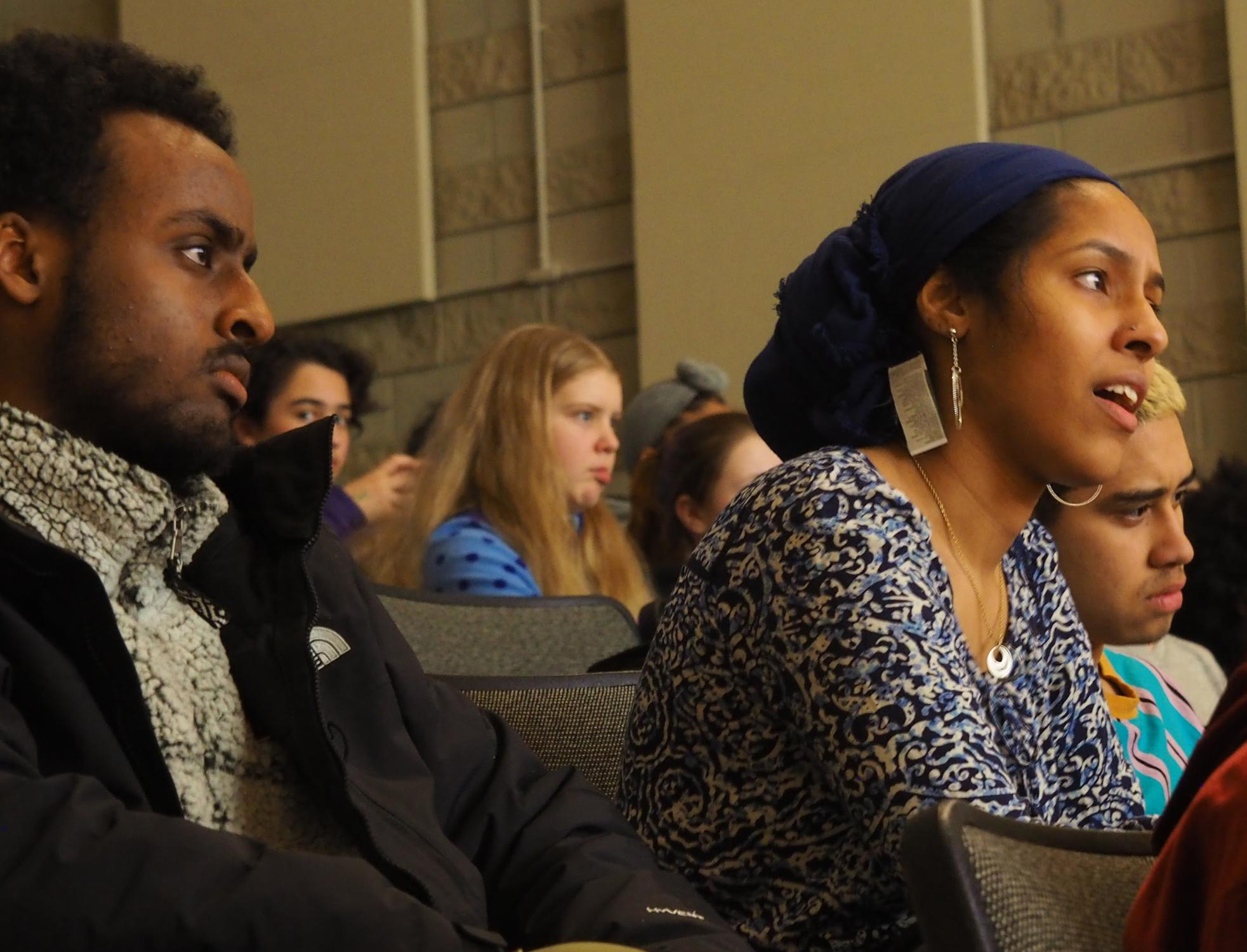 Audience members listen to a poet during the BeHeard Youth Poetry Slam. Finalists go on to represent Minnesota at the Brave New Voices International Youth Poetry Slam Festival in Las Vegas this summer. (April Carlson / The Metropolitan)