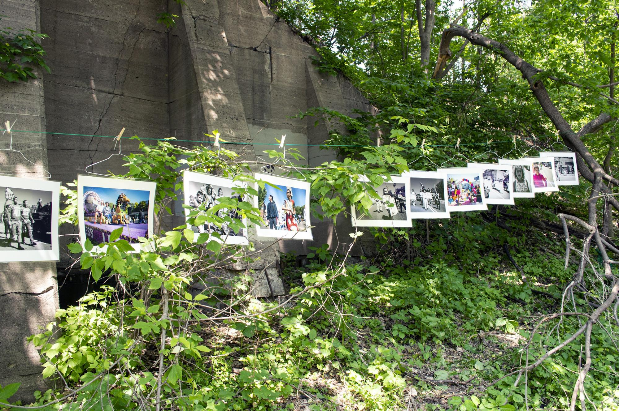 """""""Parade Through the Hollow,"""" an art installation by St. Paul photographer Stephan F. Kistler, in Swede Hollow Park on June 1. (Mandy Hathaway / The Metropolitan)"""