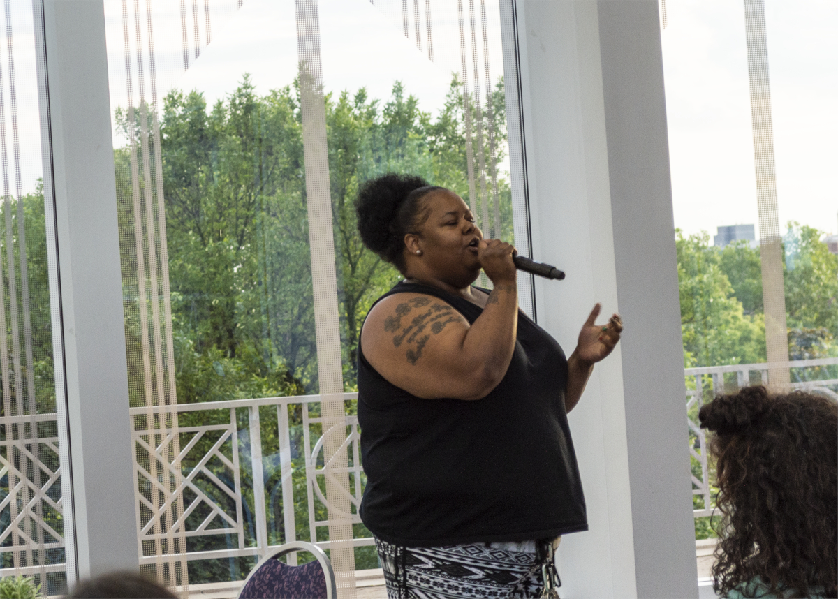 "Metro State alumni and graduate student Charisma Smith performs two original spoken word pieces 'Hood Rat' and 'The Summary' as part of the Healing from the Inside Out conference on June 19. While the pieces highlight how common sexual exploitation can be in the African American community, Smith says her goal is to say ""this what we survived not where we thrive"" and hopes that her writing, like her work, will help other women to find their ""foundation of resilience."" (Mandy Hathaway / The Metropolitan)"